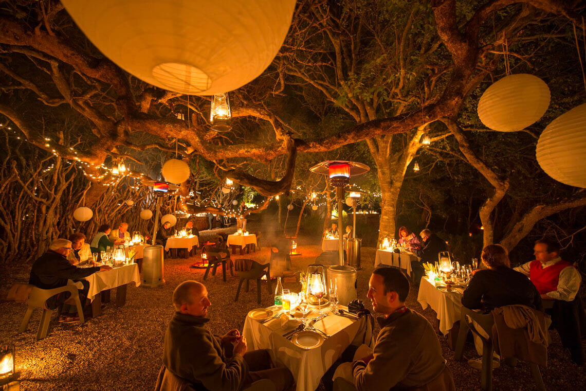 Guests dining in the outdoor Boma at Grootbos